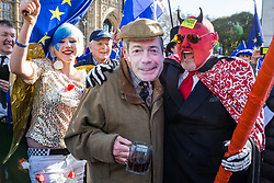 London, UK. 14th February, 2019. Anti-Brexit activists Madeleina Kay, also known as EU Super Girl, and men disguised as Nigel Farage and the devil protest outside the Houses of Parliament in Westminster.