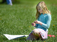 Helen Fesko, 9, of Warminster, Pennsylvania prepares her kite for flight during Kite Day Sunday April 24, 2016 at the Fonthill Museum in Doylestown, Pennsylvania. (Photo by William Thomas Cain/Cain Images)
