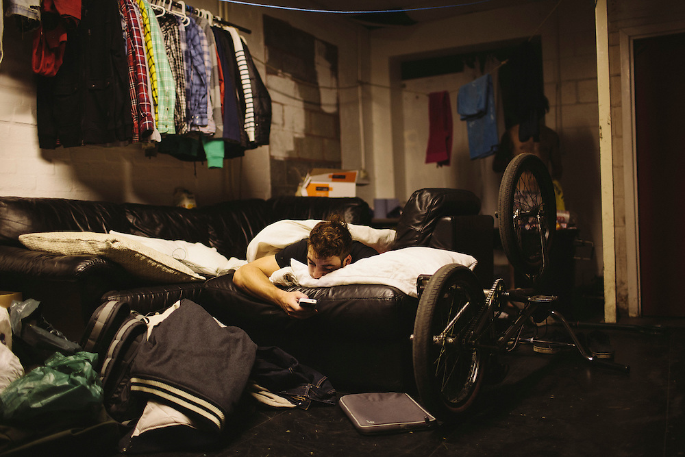 French rider Maxime Chaveron, a temporary guest at Unit 23, relaxes in his makeshift bed.