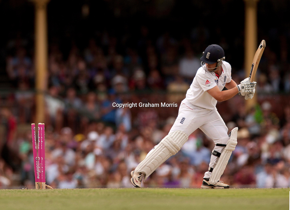 Jonathan Trott looks back as he's bowled by Mitchell Johnson for nought during the fifth and final Ashes test match between Australia and England at the SCG in Sydney, Australia. Photo: Graham Morris (Tel: +44(0)20 8969 4192 Email: sales@cricketpix.com) 04/01/11