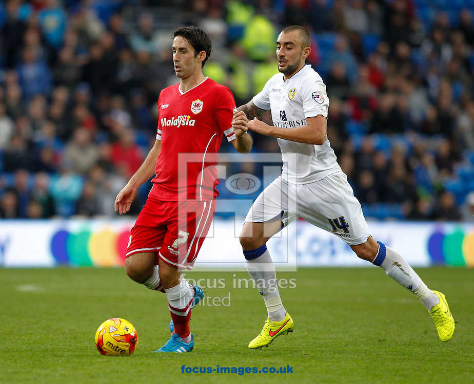 Peter Whittingham of Cardiff City and Tommaso Bianchi of Leeds United during the Sky Bet Championship match at the Cardiff City Stadium, Cardiff<br /> Picture by Mike  Griffiths/Focus Images Ltd +44 7766 223933<br /> 01/11/2014