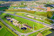 Nederland, Utrecht, Houten, 09-05-2013; rioolwaterzuivering in de 'oksel' van de afslag Houten (A27)<br /> Sewage treatment plant, surrounded by motorway exit, near Utrecht.<br /> luchtfoto (toeslag op standard tarieven)<br /> aerial photo (additional fee required)<br /> copyright foto/photo Siebe Swart