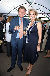 BERNARD & FIONA DREESMAN at a party for the Royal Marsden Hospital held at the Chelsea Gardener, Sydney Street, London on 6th May 2008.<br />