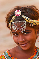 Girl with ornate jewelry in her hair, Jaisalmer Fort, Jaisalmer, Rajasthan, India