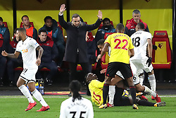 30 December 2017 - Premier League Football - Watford v Swansea City - New Swansea manager Carlos Carvalhal holds his hands up as players pile up in front of him - Photo: Charlotte Wilson / Offside