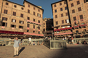 Italy, Siena, the Palio: it's early morning and people have already taken  the place in one of the best point of view, la Mossa,   where the starting point is