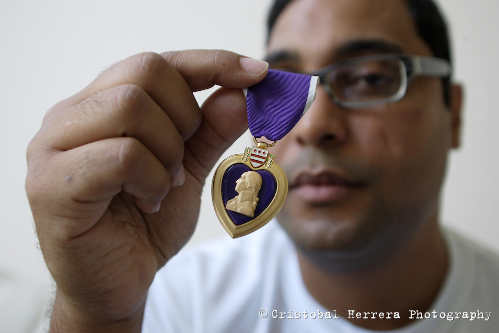 Hugo Gonzalez, retired US Army Specialist, shows the Purple Heart he was award, at his home in Hollywood on Tuesday June 16, 2009. An improvised explosive device injured Gonzalez on June 21, 2004, while serving is the US Army in Iraq.  Staff photo/Cristobal Herrera ....