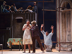 "© Licensed to London News Pictures. 10/07/2012.  London, England. L-R: Nonhlanhla Yende as Bess, Victor Ryan Robertson as Sporting Life and Xolela Sixaba as Porgy. London Premiere of Cape Town Opera's fully-staged production of the Gershwin Opera ""Porgy and Bess"" at the London Coliseum. A limited season of 14 performances from 11 to 21 July 2012. Directed by Christine Cross, Music/Lyrics by George Gershwin, DuBose and Dorothy Heyward and Ira Gershwin, accompanied by the Orchestra of Welsh National Opera. Photo credit: Bettina Strenske/LNP"