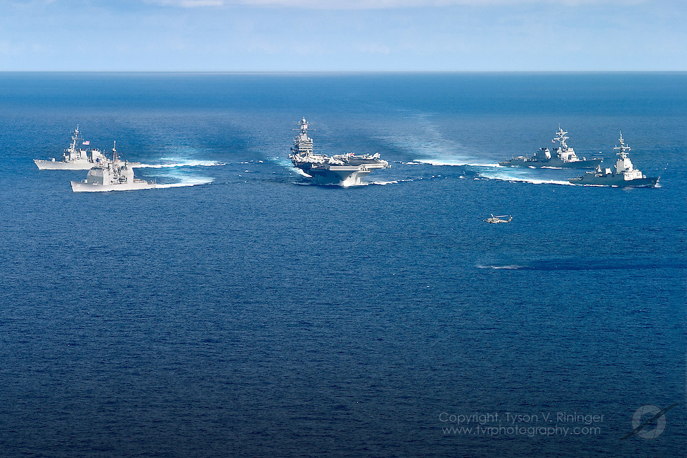 In a show of force, Carrier Strike Group Two (CSG2) consisting of the USS Theodore Roosevelt CVN-71, USS San Jacinto CG-56, USS Donald Cook DDG-75, USS Oscar Austin DDG-79 and the Spanish Frigate Álvaro de Bazán F-101, formate in the Atlantic Ocean off the coast of Florida prior to their 2005-06 Mediterranean deployment. Here they can be seen breaking formation in unison with an HH-60 from HS-3 Tridents looking on...The Spanish Frigate, Álvaro de Bazán was deployed as part of the USS Theodore Roosevelt aircraft carrier battle group in the Persian Gulf. This was the first deployment of a Spanish warship as part of an American naval battle group.