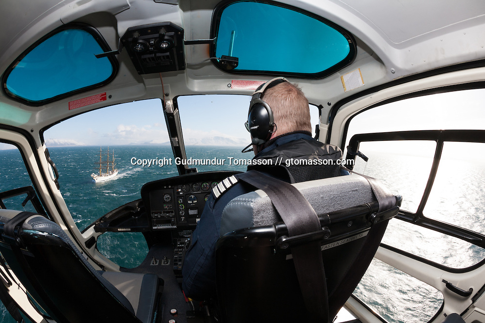 Pilot looking at Gorch Foch, a german navy training ship sailing at Faxaflói while leaving Iceland after an visit.