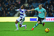Derby County goalkeeper Lee Grant (17) gives Queens Park Rangers forward Yeni Ngbakoto (23) a tug during the EFL Sky Bet Championship match between Queens Park Rangers and Derby County at Loftus Road, London, England on 14 December 2016. Photo by Jon Bromley.