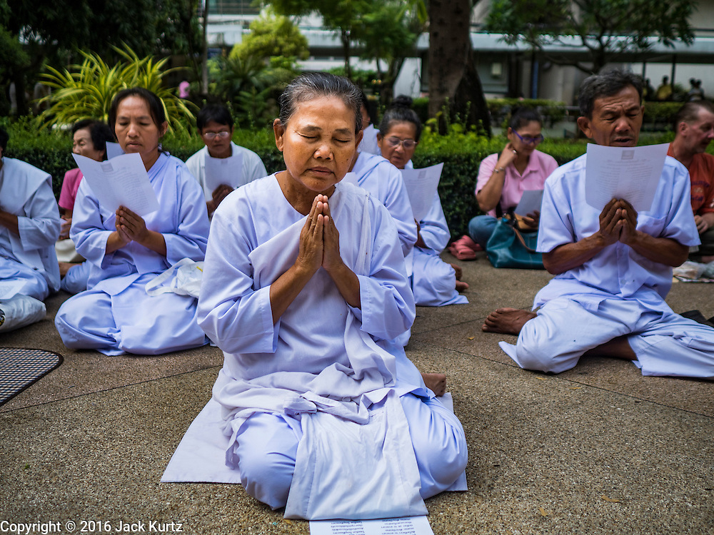 13 OCTOBER 2016 - BANGKOK, THAILAND:  A woman prays for Bhumibol Adulyadej, the King of Thailand, at Siriraj Hospital Thursday morning before the King's death was announced. Thousands of people came to the hospital to pray for the beloved monarch. Bhumibol Adulyadej, the King of Thailand, died at Siriraj Hospital in Bangkok Wednesday, October 13, 2016. Bhumibol Adulyadej, 5 December 1927 – 13 October 2016, was the ninth monarch of Thailand from the Chakri Dynasty and is known as Rama IX. He became King on June 9, 1946 and served as King of Thailand for 70 years, 126 days. He was, at the time of his death, the world's longest-serving head of state and the longest-reigning monarch in Thai history.      PHOTO BY JACK KURTZ