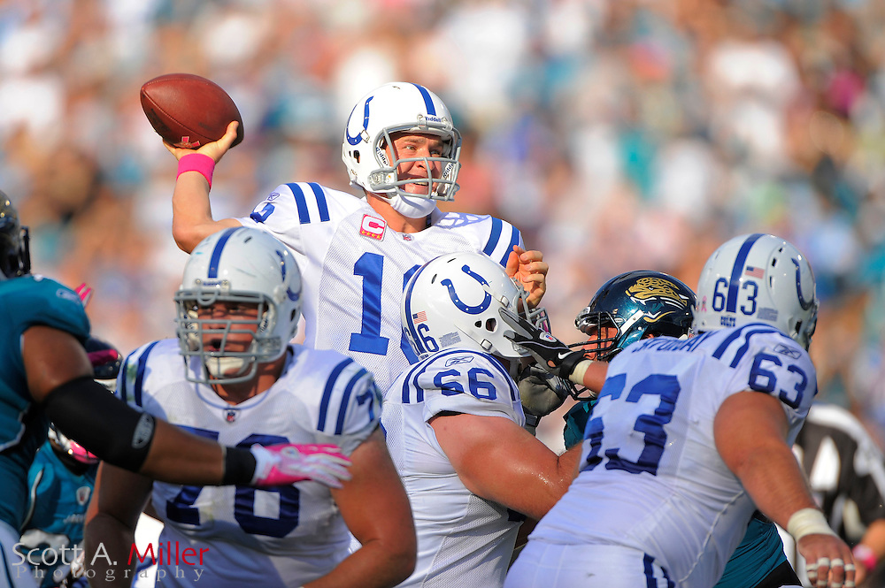 Oct. 3, 2010; Jacksonvile, FL, USA; Indianapolis Colts quarterback Peyton Manning (18) throws down field during the Colts game against the Jacksonville Jaguars at the EverBank Field. ©2010 Scott A. Miller