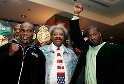 WBA/WBC/Ring Magazine Cruiserweight Champ Jean-Marc Mormeck (l) and IBF Cruiserweight Champ O'Neill Bell (r) pose with promoter Don King at the presser announcing their upcoming fight.  The two will meet in a Cruiserweight Unification at the Theater at Madison Square Garden on January 7, 2006.