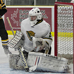 COBOURG, ON - Dec 3 : Ontario Junior Hockey League Game Action between Cobourg Cougar's Hockey Club & Aurora Tiger's Hockey Club, during third period game action, Nathan Perry #29 of the Cobourg Cougars makes the save.(Photo by Dave Powers / OJHL Images)