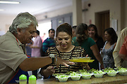 Food being served for a meal for a Chile themed lunch social event at Missao Paz, São Paulo, Brazil.<br /> <br /> Missao Paz provides advice and support on employment, health, family, community and education. They also have residential quarters where people can stay when they have no where else. <br /> <br /> Their mission is to welcome, understand, integrate and celebrate the lives of immigrants and refugees, dreaming of a universal citizenship.