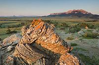Sandstone rock formations glowing in the sunrise light, Rocky Mountain Front Range near Choteau Montana