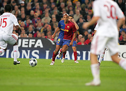 Thierry Henry of Barcelona runs with the ball during the UEFA Champions League quarter final first leg match between FC Barcelona and FC Bayern Munich at the Camp Nou stadium on April 8, 2009 in Barcelona, Spain.