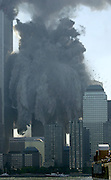 The view of the second tower collapsing from the  New York Waterway ferry dock on the  Jersey City waterfront on 09/11/01.