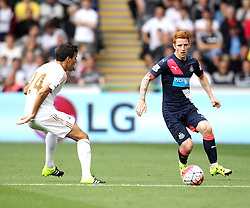 Jack Colback of Newcastle United passes past Jack Cork of Swansea City - Mandatory byline: Robbie Stephenson/JMP - 07966386802 - 15/08/2015 - FOOTBALL - Liberty Stadium -Swansea,England - Swansea City v Newcastle United - Barclays Premier League