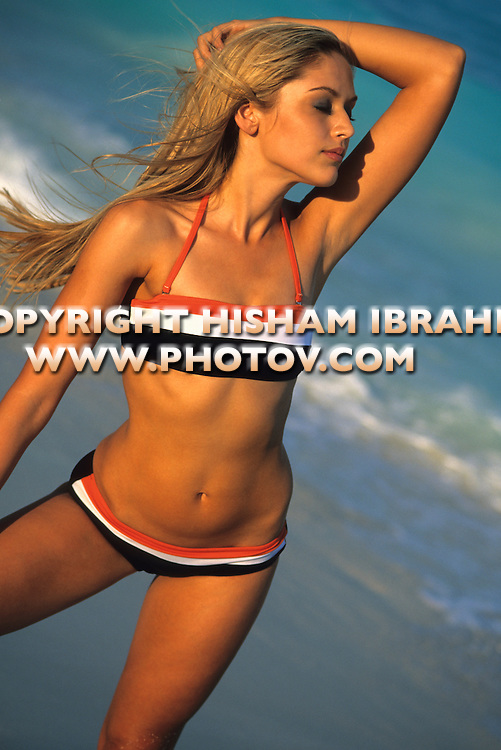 Sexy Blonde woman in bikini on the beach, Cancun, Mexico