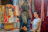 artist Stacey Evangelista doing portrait of Asia Collett<br /> art event at Washington Pavilion called &quot;Take the Day&quot;