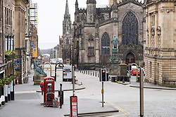 Edinburgh, Scotland, UK. 24 March, 2020.  Deserted streets in the heart of the Old Town tourist district in Edinburgh. All shops and restaurants are closed with very few people venturing outside following the Government imposed lockdown today. Pictured; View along the High Street and Royal Mile. Iain Masterton/Alamy Live News