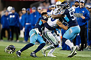 NASHVILLE, TN - DECEMBER 30:  Jayon Brown #55 and Malcolm Butler #21 of the Tennessee Titans loses his helmet while tackling Jordan Wilkins #20 of the Indianapolis Colts at Nissan Stadium on December 30, 2018 in Nashville, Tennessee.  The Colts defeated the Titans 33-17.   (Photo by Wesley Hitt/Getty Images) *** Local Caption *** Malcolm Butler; Jordan Wilkins; Jayon Brown