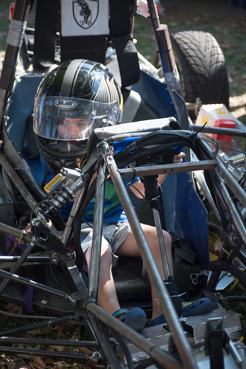 9/24/17 – Medford/Somerville, MA – Child plays with the steering wheel on stationary kart during Tufts Community Day on September 24. (Seohyun Shim / The Tufts Daily)
