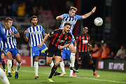 AFC Bournemouth defender Simon Francis (2) with a header at goal during the EFL Cup match between Bournemouth and Brighton and Hove Albion at the Vitality Stadium, Bournemouth, England on 19 September 2017. Photo by Adam Rivers.