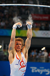 Netherland's Epke Zonderland falls from the high bar of artistic gymnastics apparatus finals during the Olympic games in Beijing, China, 19 August 2008.