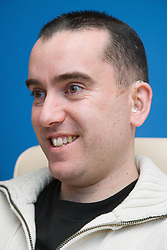 Man with a hearing impairment smiling,
