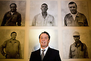 Manuel Pinho, economy minister , near photos of his private collection in the economy ministery in Lisbon. photo  Miguel Ribeiro Fernandes.