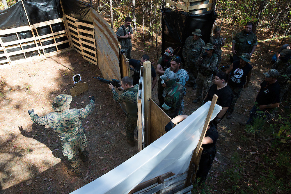 """Militia members from the several states, all of whom identify as part of the III% movement, gather near Jackson, Ga. on Saturday, Oct. 29, 2016 for training exercises. Here, Chris Hill, who goes by Bloodagent and is commanding officer of Georgia Security Force III%, shows militia members a """"kill house"""" that they will use for training. Photo by Kevin D. Liles for The New York Times"""