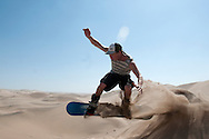 Elia Pons takes a jump built in the sand dunes outside of Huacachina in Peru.