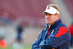 November 6, 2010; Stanford, CA, USA;  Arizona Wildcats head coach Mike Stoops watches his team warm up before the game against the Stanford Cardinal at Stanford Stadium.
