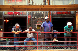 Stock photo of four men taking a break on a construction site in downtown Houston Texas.