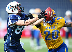 01.06.2014, NV Arena, St. Poelten, AUT, American Football Europameisterschaft 2014, Gruppe A, Finnland (FIN) vs Schweden (SWE), im Bild Aappo Saloranta, (Team Finland, WR, #88) und  Olaf Eriksson, (Team Sweden, DB, #20) // during the American Football European Championship 2014 group A game between Finland and Sweden at the NV Arena, St. Poelten, Austria on 2014/06/01. EXPA Pictures © 2014, PhotoCredit: EXPA/ Thomas Haumer