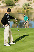 Golfer Watching Friend Make Shot