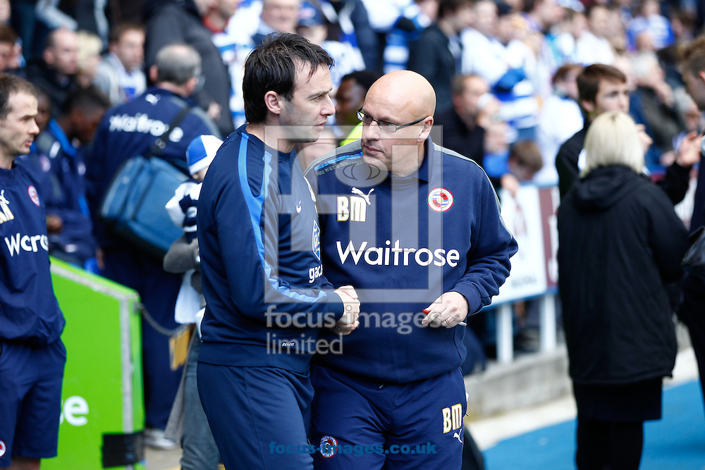 Picture by Andrew Tobin/Focus Images Ltd. 07710 761829 - 21/04/12 - Dougie Freedman - manager of Crystal Palace (L) shakes hands with Brian McDermott (R) before the during the Npower Championship match at Madejski Stadium, Reading.