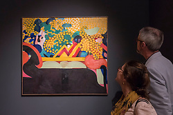 "© Licensed to London News Pictures. 29/06/2017. London, UK.  Members of the public view ""The Meeting"", 1963-65, by Howard Hodgkin during a visit to Masterpiece London, a leading art fair held in the grounds of the Royal Hospital Chelsea.  The fair brings together 150 international exhibitors presenting works from antiquity to the present day and runs 29 June to 5 July 2017.  Photo credit : Stephen Chung/LNP"