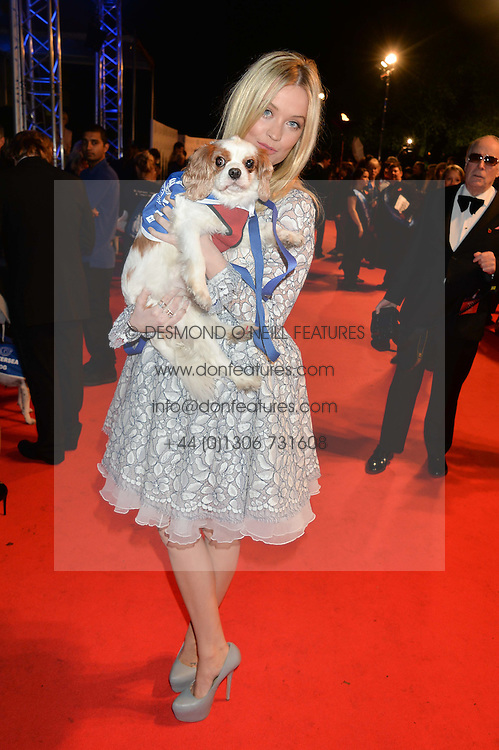 LAURA WHITMORE and Battersea dog at Battersea Dogs & Cats Home's Collars & Coats Gala Ball held at Battersea Evolution, Battersea Park, London on30th October 2014.