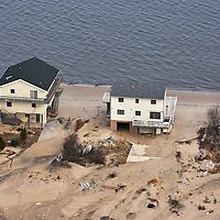 Houses on the north end of Shore Dr., Prime Hook Beach, DE.  The houses have been washed under by the storm surge.