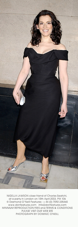NIGELLA LAWSON close friend of Charles Saatchi, at a party in London on 15th April 2003. PIX 106