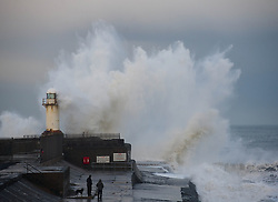 © Licensed to London News Pictures. 19/01/2014<br /> <br /> Teesside, England<br /> <br /> Huge waves crash over the lighthouse at the end of South Gare at the mouth of the River Tees in Teesside.<br /> <br /> Photo credit : Ian Forsyth/LNP