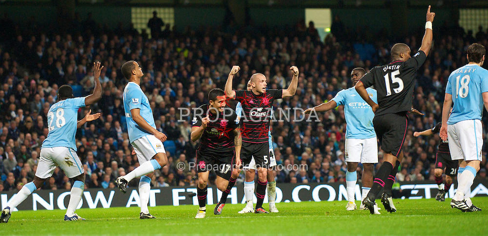 MANCHESTER, ENGLAND - Wednesday, March 24, 2010: Everton's Tim Cahill celebrates scoring the opening goal against Manchester City during the Premiership match at the City of Manchester Stadium. (Photo by David Rawcliffe/Propaganda)