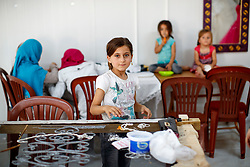© Licensed to London News Pictures. 28/05/2017. Antakya, TURKEY. Syrian children make jewellery at Altınözü refugee camp on the Turkish-Syrian border in Antakya, Turkey on the first day of Ramadan during Former Minister of State for Faith and Communities, Baroness Warsi's visit. Photo credit: Tolga Akmen/LNP