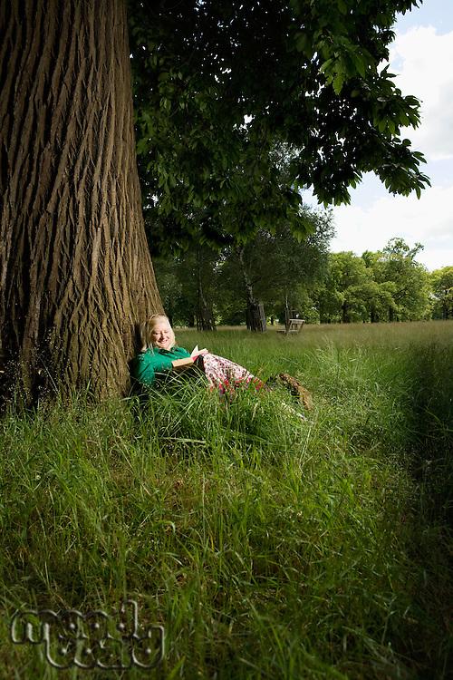 Woman Sitting Beneath a Tree