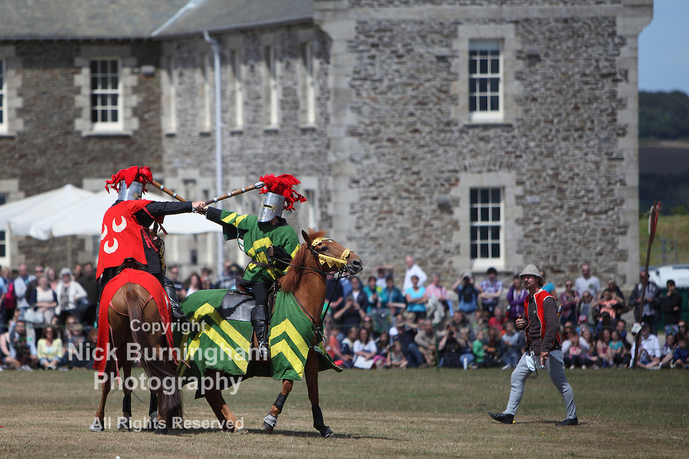 FALMOUTH, CORNWALL, UK - JULY 29, 2013 - Medieval jousting reenactments take place at Pendennis Castle on July 29, 2013. The castle was built in the 1539 by King Henry VIII.