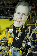 January 04 2010: An Iowa fan holds up a cutout of Iowa Hawkeyes head coach Fran McCaffery's head during the second half of an NCAA college basketball game at Carver-Hawkeye Arena in Iowa City, Iowa on January 04, 2010. Ohio State defeated Iowa 73-68.